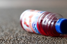 Half drank bottle of Ocean Spray Cranberry abandoned by its owner.