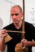 Paco Hadley strung his instrument called a berimbau.