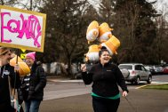 """Women enters with the Trump """"Baby"""" balloons."""