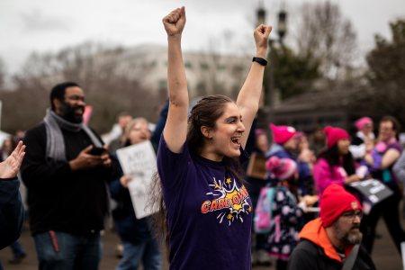 Sarah Lynn Bennett cheers on the accomplishments of the crowd.
